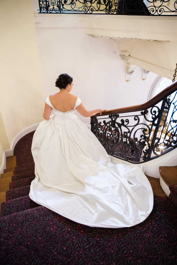 Tupper Manor bride walking down stairs