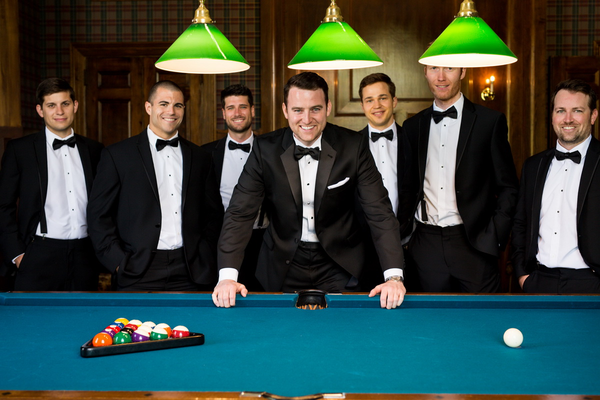 Tupper Manor groomsmen standing in front of pool table
