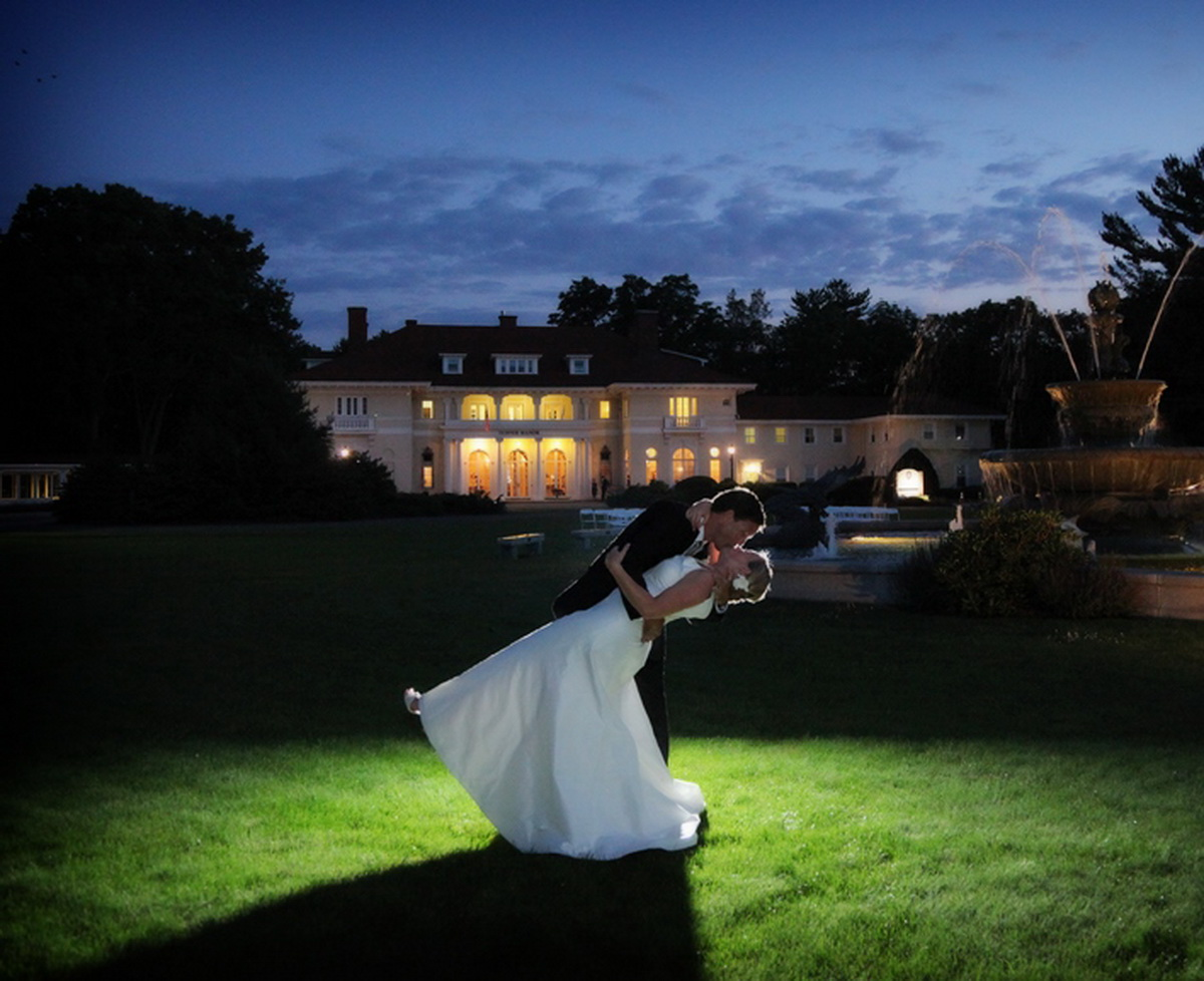 Tupper Manor groom dipping bride on front lawn at night
