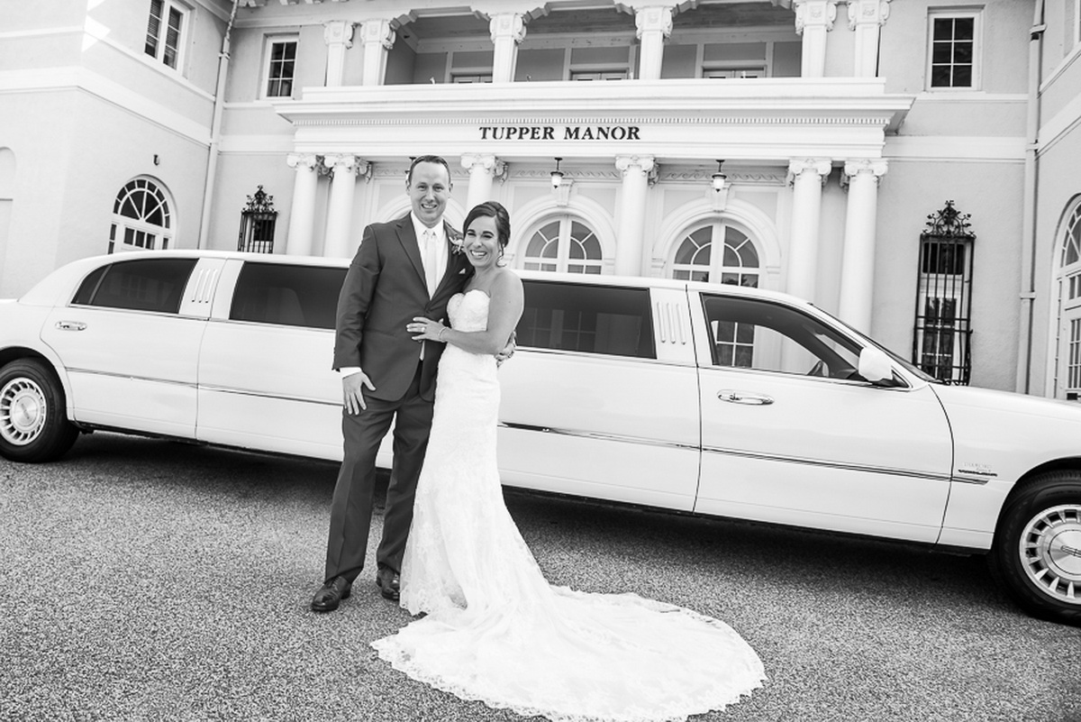 Tupper Manor wedding cxouple standing in front of limo