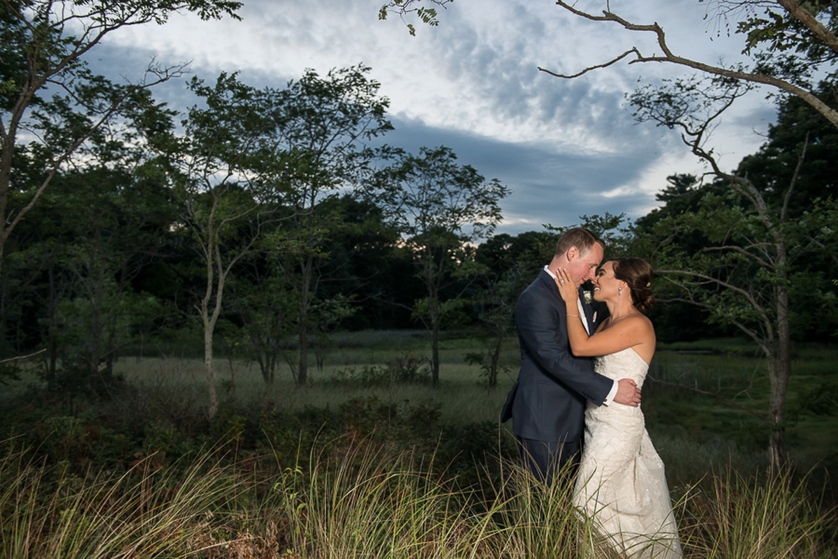Tupper Manor bride and groom on romantic grounds