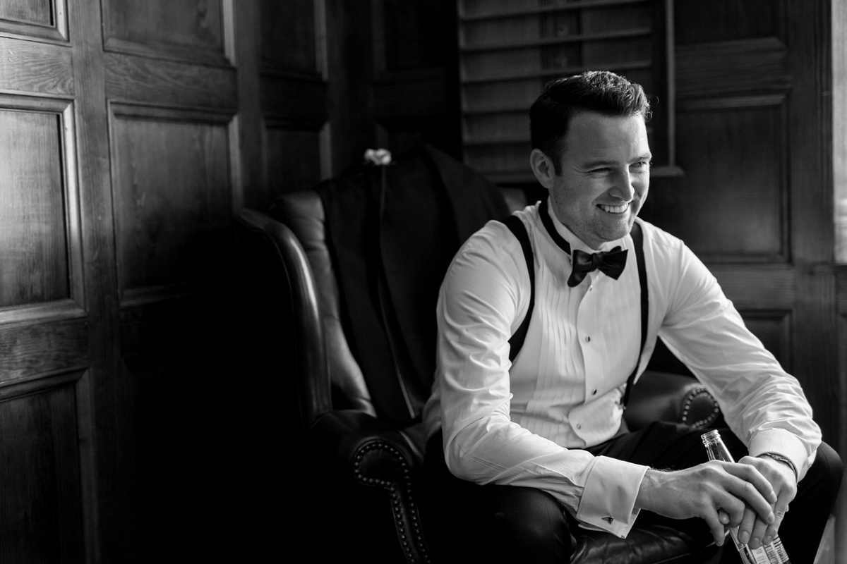 Tupper Manor b&w photo groom smiling