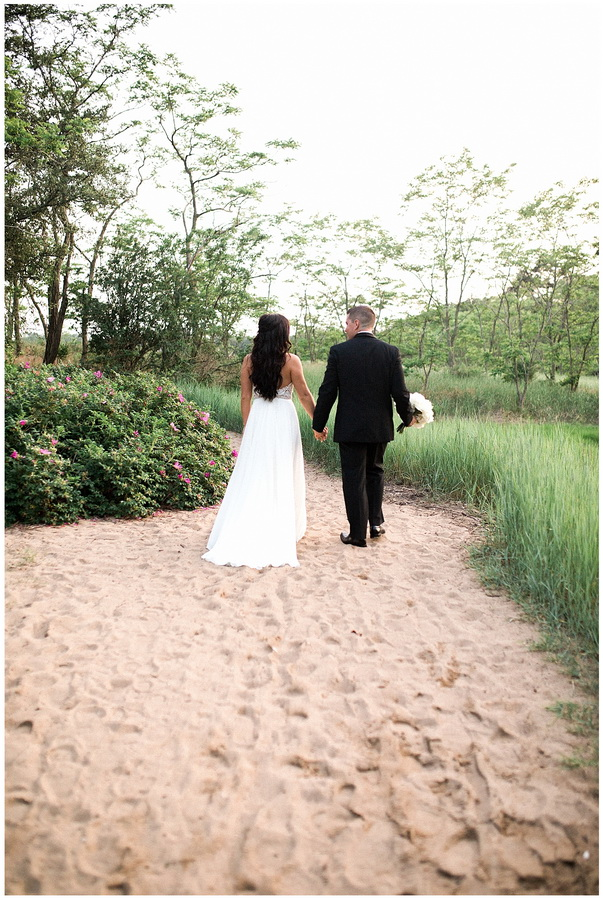 bride groom walking on beach